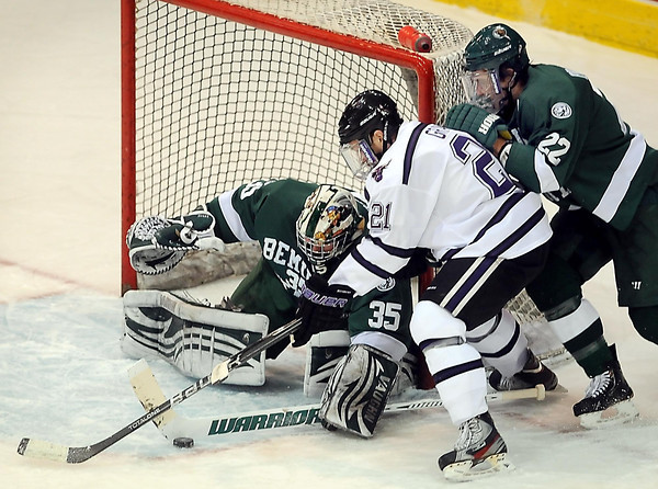 Minnesota State University's Chase Grant tries to get the puck past Bemidji goalie Mathieu Dugas and defender Matt Prapavessis (22) during first period aciton at the Verizon Wireless Center in Mankato.