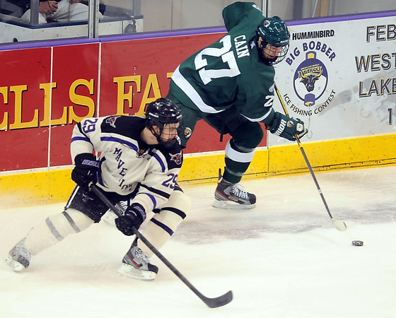 Minnesota State's Eli Zuck keeps an eye on Bemidji State's Mitch Cain during the first period Saturday at the Verizon Wireless Center.