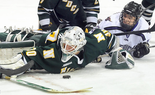 Pat Christman<br /> Minnesota State's Jean-Paul Lafontaine watches as the puck sits in front of Northern Michigan goalie Mathies Dahlstrom during the second period Friday at the Verizon Wireless Center.