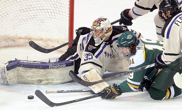 Pat Christman<br /> Minnesota State goalie Stephon Williams keeps an eye on the puck as University of Alaska-Anchorage's Bobby Murphy tries to get a shot off during the first period Saturday at the Verizon Wireless Center.