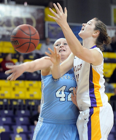 Pat Christman<br /> Upper Iowa's Carly Pagel hits the ball out of the hands of Minnesota State's Ali Wilkinson during the first half Friday at Bresnan Arena.