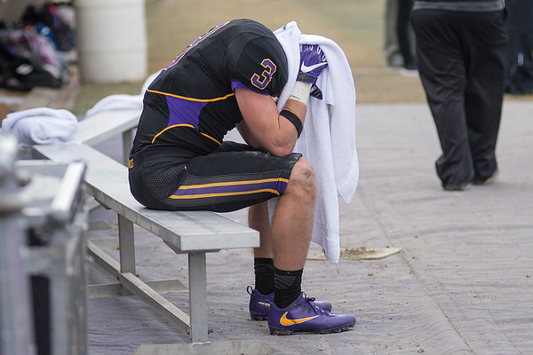 Minnesota State's Corey Brent (3) sits on the bench with his head in a towel as the chances of MSU catching up to Texas A&M Commerce began to slip away. Photo by Jackson Forderer