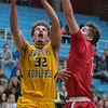 Gustavus' Jason Faul (32) goes in for a layup against St. Mary's Jason Timm during Wednesday's MIAC conference game. Photo by Jackson Forderer