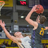 Minnesota State's Kevin Krieger (25) collides with Augustana's Adam Dykman on his way to the basket during the second half of Saturday's game played at Bresnan Arena. Krieger was called for a charge on the play, but lead the Mavericks with 29 points to seal a 90-79 win. Photo by Jackson Forderer