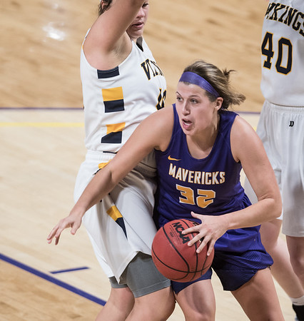 Minnesota State forward Mackenzie Dahl (32) dribbles the ball below the Maverick's basket in the second half of their match against Augustana Saturday Photo by Casey Ek