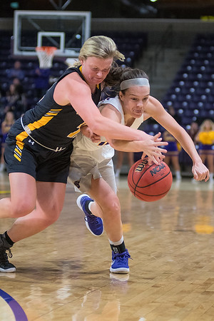 Minnesota State's Logan Anderson (right) goes after the ball against Wayne State's Maggie Lowe after Anderson lost control of the ball in the first half of Friday's game played at Bresnan Arena. Photo by Jackson Forderer