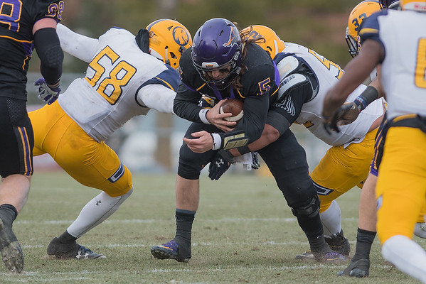 Minnesota State's Ryan Schlichte is sacked by two Texas A&M Commerce defensemen in the second half. The Texas A&M Commerce pass rush gave the MSU quarterbacks little time to throw. Photo by Jackson Forderer