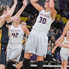 Minnesota State's Taylor Drost (30) goes up for a shot in the lane during the Mavericks game against Wayne State on Friday. Photo by Jackson Forderer