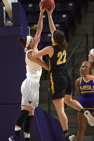 Minnesota State's Claire Jordan (left) blocks a shot from Erin Norling (22) of Wayne State during the first half of Friday's NSIC conference game played on Friday. Photo by Jackson Forderer