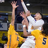 Minnesota State's Juwan McCloud goes in for a finger roll over Concordia-St. Paul's Isaiah McKay (left) and Lee Higgins (5) in the second half of Saturday's game at Bresnan Arena. The Mavericks held their first half lead steady in the second half and won 91-72. Photo by Jackson Forderer