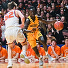 Joich Gong of Mankato East drives the baseline against a Delano defender in last year's state quarterfinal game played at Williams Arena on March 21, 2018. Photo by Jackson Forderer