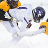 Minnesota State's Jack Curtis (right) and Parrish Marrow (left) converge on Tarleton State's Zimari Manning for a tackle, stopping Manning on a fourth down and Tarleton's final offensive play of the game. The Mavericks won Saturday's game in blizzard conditions 13-10 to move to the NCAA Division II semifinals. Photo by Jackson Forderer