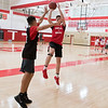 Tory Lindblom, a senior on the Mankato West boys basketball team, takes a fade away jump shot over a teammate during practice on Thursday. Photo by Jackson Forderer