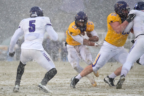 Minnesota State's Nate Gunn follows his blocker Evan Heim as Tarleton State's EJ Speed (5) looks to make a tackle on the play. Gunn carried the ball 50 times for 261 yards for the Mavericks in their win. Photo by Jackson Forderer