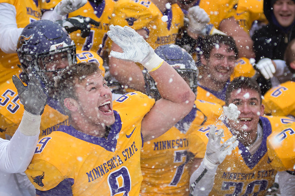 Minnesota State's Michael Palme (9) throws snow in the air like confetti while celebration the Mavericks 13-10 come from behind victory over Tarleton State at Blakeslee Field on Saturday. Photo by Jackson Forderer