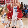 Lani Schoper (second from left) and Amanda Younge (right) of Mankato West fight for a rebound against Owatonna's Emma Dahnert (32) in the second half of Friday's game. Photo by Jackson Forderer