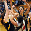 Mankato East's Taylor Karge steals a pass from Rochester John Marshall's Allison Radke with help from teammate Bria Armstrong during the first half Friday at the East gym.