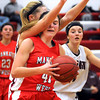 Mankato West's Cara Christiansen collides with New Prague's Lexi Ruehling while driving the lane during the first half Thursday at the West gym.