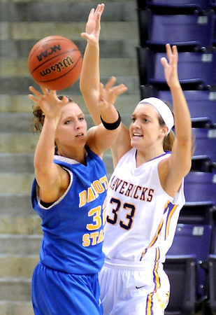 Dakota State's Cassie Jacobsen passes away from the defense of Minnesota State's Jamie Bresnahan during the first half Wednesday at Bresnan Arena.