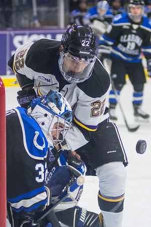 Minnesota State's Dallas Gerads (22) and Alabama Huntsville's goalie Jordan Uhelski watch the puck fly through the crease in the first period of Friday's game. The Mavericks won 5-1. Photo by Jackson Forderer