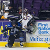 Minnesota State's Nicholas Rivera (23) keeps trying to play the puck even after being upended by Alabama Huntsville's Cody Champagne (5) in the second period. Rivera added a goal in the third period to help the Mavericks to a victory. Photo by Jackson Forderer