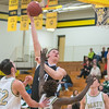Mankato East's Jordan Merseth puts up a hook shot over four Rochester Mayo defenders in the second half of Thursday's Big Nine conference game. Photo by Jackson Forderer