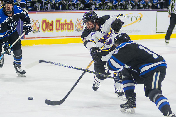 Zen Knutson of Minnesota State takes a shot on goal past Alabama Huntsville's Madison Dunn (right) during the first period of Friday's game. Photo by Jackson Forderer