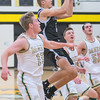Jax Madson of Mankato East puts up a floater during a fast break as the Cougars rallied from behind Rochester Mayo to win 78-71. Photo by Jackson Forderer