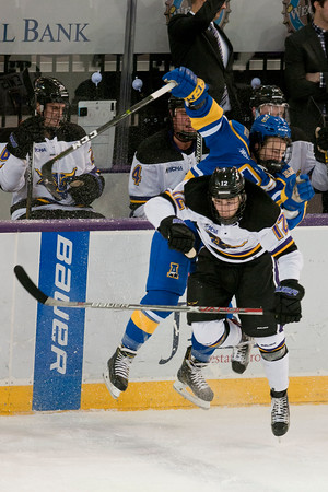 Max Coatta collides with a Alaska Nanooks player in the first period. Photo by Jackson Forderer