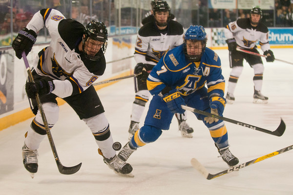 Minnesota State's Daniel Brickley (8) flips the puck into the corner in the second period against the Alaska Nanooks. Photo by Jackson Forderer
