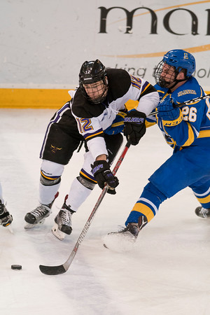 Max Coatta fights for the puck against the Nanooks' Tyler Cline. Photo by Jackson Forderer
