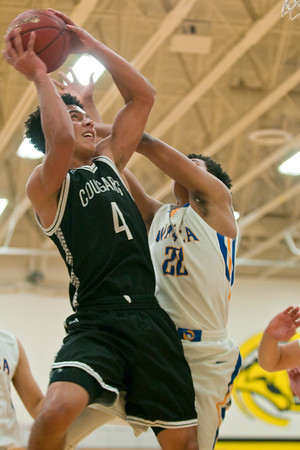 Damani Hayes (4) of Mankato East is fouled by Waseca's Kaleb Nelson in the first half of play. The East boys basketball team opened their season by hosting Waseca on Thursday. Photo by Jackson Forderer