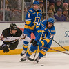 Max Coatta (12) dives for the puck in the second period against the Alaska Nanooks. Photo by Jackson Forderer