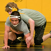 Sheng Haley practices with a teammate at Mankato East on Wednesday afternoon. Haley wrestles in the 132-pound weight division and is one of the two seniors on the team. Photo by Jackson Forderer