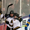 Zeb Knutson and Parker Tuomie celebrate a first-period goal. Photo by Jackson Forderer