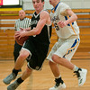 Mankato East's Alex Turner (3) drives the lane against Waseca's Cole Streich (5) during the first half in East's season opener played on Thursday. Photo by Jackson Forderer