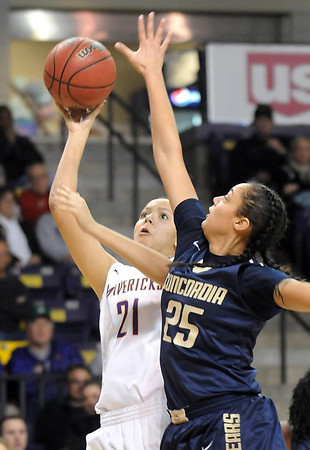 Pat Christman<br /> Minnesota State's Tyra Johnson shoots past Concordia-St. Paul's Kionda Nicks during the second half Saturday at Bresnan Arena.