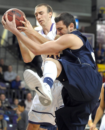 Pat Christman<br /> Minnesota State's Connor O'Brien and Concordia-St. Paul's Shea Mandli both grab a rebound during the first half Saturday at Bresnan Arena.