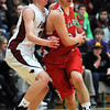 Pat Christman<br /> Fairmont's Taylor Beebe defends St. Clair's Austin Nagel during the first half of the championship game in the Pepsi Holiday Basketball Tournament Saturday at Bethany Lutheran College.