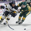 Minnesota State's Nicholas Rivera (23) goes after the puck while being defended by Northern Michigan's Jordan Klimek in the second period of Friday's game. Photo by Jackson Forderer