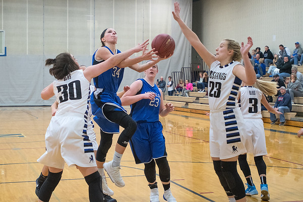 Nicollet/Mankato Loyola's Brooke Skrien (34) puts up a shot against Buffalo Lake-Hector-Stewart's Rachel Dean (30) and Sara Kottke (23) in the second half of Thursday's game played in Nicollet. The Raiders won the game 71-51. Photo by Jackson Forderer