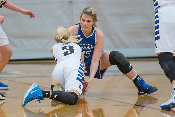 Nicollet/Mankato Loyola's Lindsey Boerger (right) fights for a loose ball against Buffalo Lake-Hector Stewart's Kylie Ehlers (3) in the second half of Thursday's game. The Raiders won the game 71-51. Photo by Jackson Forderer