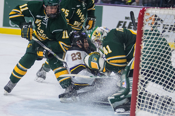 Minnesota State's Nicholas Rivera (23) gets sandwiched between Northern Michigan's goalie Atte Tolvanen and Adam Rockwood (11) while rushing the net in Friday's 4-3 loss. Photo by Jackson Forderer