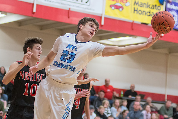 Minnesota Valley Lutheran's Mason Cox reaches out for a rebound in the Kwik Trip Holiday Tournament semifinal game against New Richland-Hartland-Ellendale-Geneva played at Bethany Lutheran. The Chargers cruised into the final game with a victory over the Panthers. Photo by Jackson Forderer