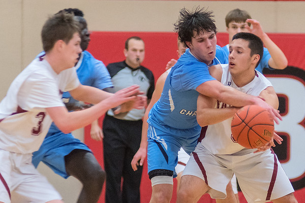 Minnesota Valley Lutheran's Matt Munsen tries to steal the ball away from Pete Ortega of Fairmont as Ortega tried to pass the ball to his teammate Jack Hested during the Kwik Trip Holiday Tournament championship game. Photo by Jackson Forderer