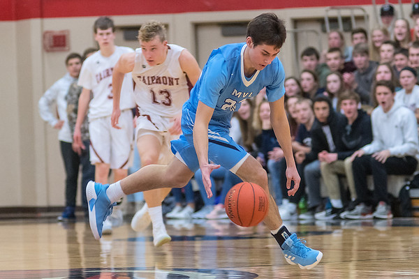 Jace Marotz of Minnesota Valley Lutheran picks up a loose ball and starts a fast break in the second half of play in the Kwik Trip Holiday Tournament championship game. Photo by Jackson Forderer