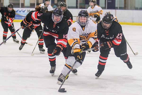 Mankato East's McKenzie Keller (center) gets a step ahead of Marshall's Maddy Penske (right) and KC Boerboom (left) during Saturday's game. The game, which went to overtime, finished in a 3-3 tie. Photo by Jackson Forderer