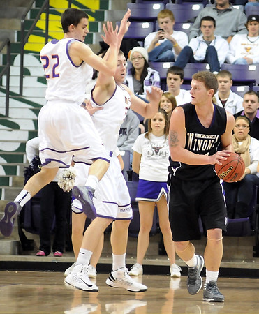 Minnesota State's Zach Monaghan (22) and Zach Romashko defend Winona State's Claton Vette during the first half Friday at Bresnan Arena.