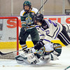Minnesota State's Teddy Blueger falls over University of Alaska Anchorage goalie Chris Kamal as he watches a shot by MSU's Chase Grant go into the net during the second period Saturday at the Verizon Wireless Center.