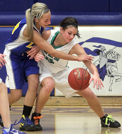 Mankato Loyola's Jordyn Strachan slaps the ball away from Waterville-Elysian-Morristown's Shayna Kinniry during the first half Tuesday at the Fitzgerald gym.